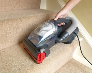 Cleaning stairs with a vacuum cleaner