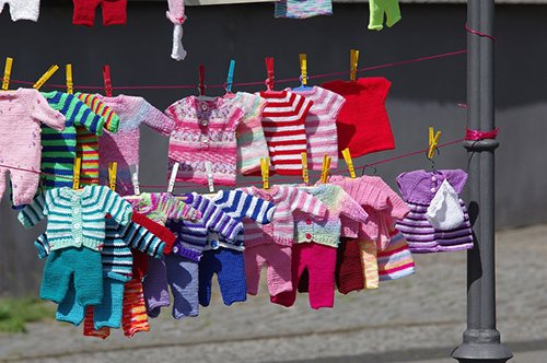 Childrens clothes on washing line